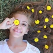 girl smiling with flowers in hair